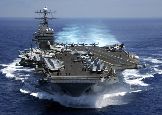 "050315-N-3241H-001 USS Carl Vinson (March 15, 2005) -- Prior to the first launch, nuclear powered aircraft carrier USS Carl Vinson or the ""Gold Eagle"", teamed up with Carrier Airwing 9, steams through the Indian Ocean at over 30 knots. The Carl Vinson Strike Group is currently on a six-month deployment to promote peace and stability and respond to emergent events overseas. USS Carl Vinson will end its deployment with a homeport shift to Norfolk, Va., in support of a three-year refuel and complex overhaul. U.S. Navy Photo by Photographer's Mate Third Class Dusty Howell"