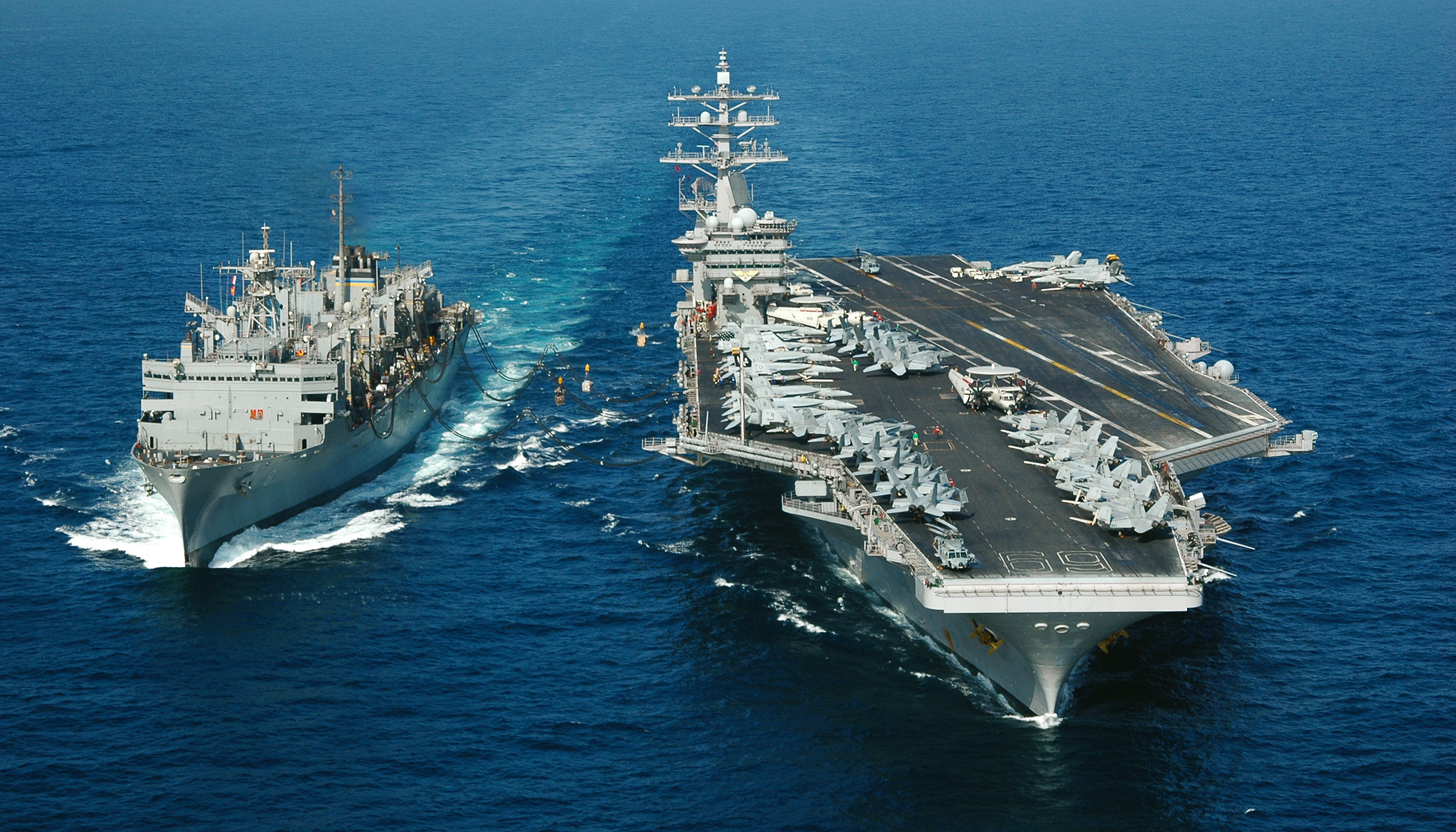 The fast combat support ship USNS Arctic (T-AOE 8), left, conducts an underway replenishment with the Nimitz-class aircraft carrier USS Dwight D. Eisenhower (CVN 69) Jan. 15, 2007. Eisenhower and embarked Carrier Air Wing 7 are on a regularly scheduled deployment in the U.S. Naval Forces Central Command area of responsibility in support of maritime security operations. (U.S. Navy photo by Mass Communication Specialist 2nd Class Miguel Angel Contreras) (Released)